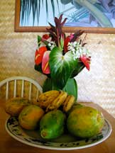 Table with anthurium and papaya